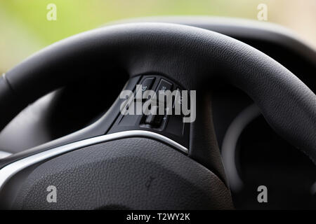 The steering wheel of a good modern car with navigator. - Stock Image