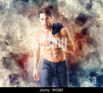 Young man with fire explosion or flame burst behind him - Stock Image