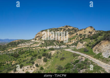 Lone hiking trail leads along the side of a rocky canyon valley near Santa Clarita. - Stock Image
