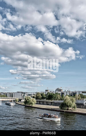 River Spree, Tour boats, government district, clouds, Berlin, Germany - Stock Image