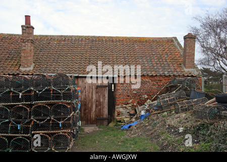 Fish sheds at Brancaster Norfolk East Anglia - Stock Image