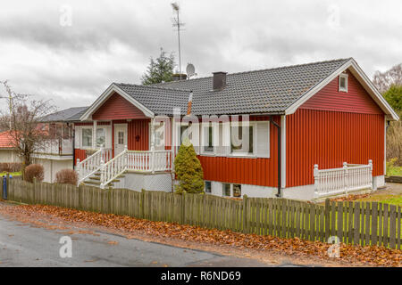 FLODA, SWEDEN - NOVEMBER 21 2018: Typical Swedish red painted wood with white trim detached house or bungalow with a basement - Stock Image