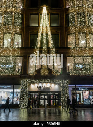 Exterior or and entrance to the Frasers Department Store in Bucanan Street, central Glasgow, Scotland, decorated with cascading lights for Christmas.  - Stock Image