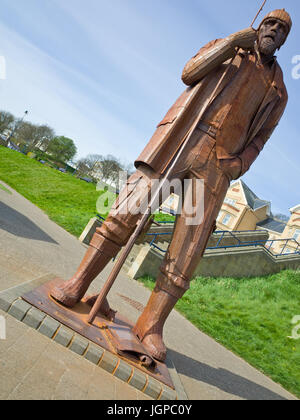 Ray Lonsdale Statue Filey High Tide Short Wellies North Yorkshire UK - Stock Image