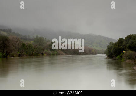 Putah Creek off Winters, California, USA, on a winter day with fog, long-exposure - Stock Image