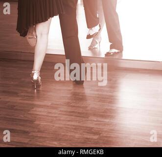 Ballroom dance couple of dancers and teachers in studio school dancing in rehearsal. - Stock Image