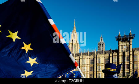 European Union and British Union Jack flag flying in front of Houses of Parliament at Westminster Palace, London in symbol of the Brexit EU referendum - Stock Image