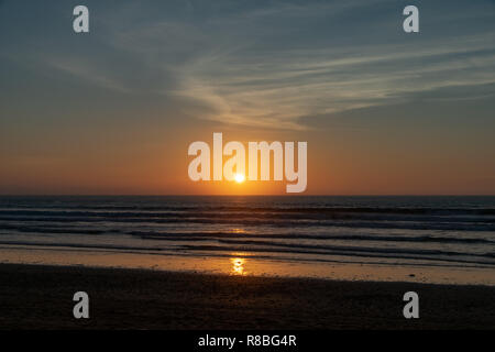 No people with a golden sunset over the Atlantic Ocean from Agadir Beach, Morocco, Africa - Stock Image