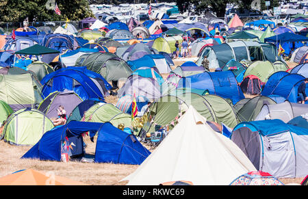A view of the packed camping area of the Latitude festival 2018 with Henham Park taken from one of the security watch towers. - Stock Image