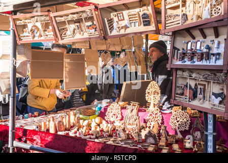 Cambridge, England - October 2018: Christmas market stall selling wooden crafts in Market Square, cambridge, UK. - Stock Image