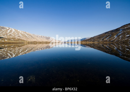 Hills reflected in Loch Cluanie, Kintail - Stock Image
