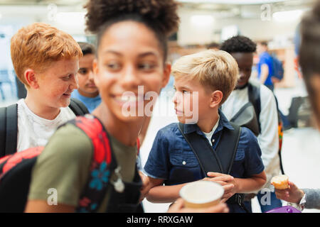 Junior high students hanging out - Stock Image