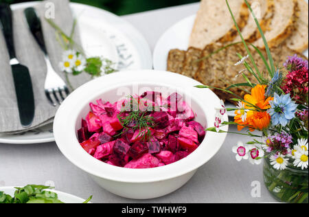 Swedish salad of pickled beetroot and apple traditionaly served at midsummer party - Stock Image