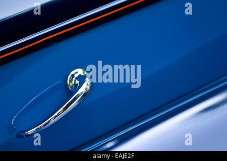 Closeup on shiny door handle of retro car - Stock Image