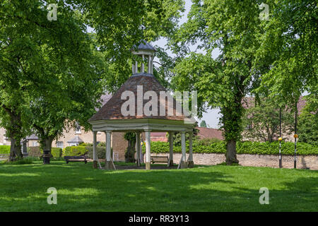The 18th century Market House or Buttermarket on the village green at Harrold, Bedfordshire, UK - Stock Image