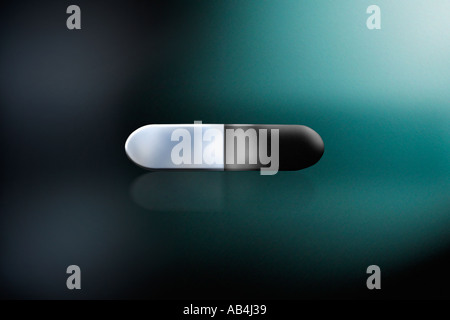 pill on a green background - Stock Image