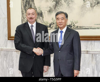 Beijing, China. 24th Apr, 2019. Wang Yang (R), chairman of the Chinese People's Political Consultative Conference National Committee, meets with Azerbaijani President Ilham Aliyev ahead of the Second Belt and Road Forum for International Cooperation in Beijing, capital of China, April 24, 2019. Credit: Gao Jie/Xinhua/Alamy Live News - Stock Image