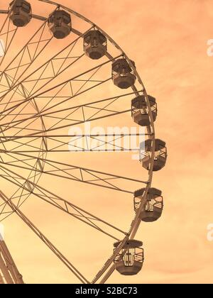 A section of a Ferris Wheel. Entertainment for both children and adults - even if you just go round in circles! Photo Credit - © COLIN HOSKINS. - Stock Image