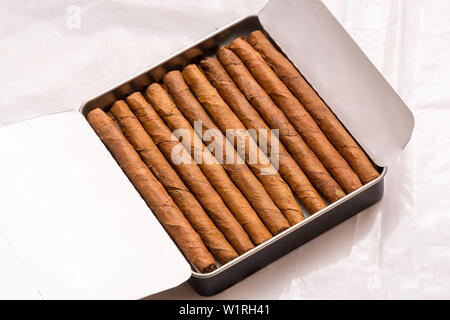 Box of cigarillos on white background - Stock Image