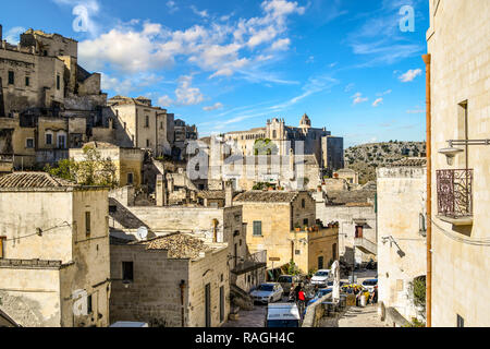 Matera, Italy - September 24 2018: A cathedral is seen in the distance over the old town section of Matera, Italy - Stock Image