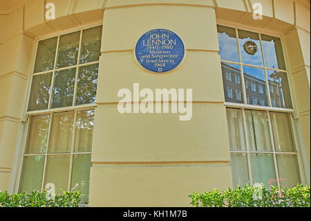 Circular blue plaque on a building façade in London highlighting John Lennon lived in the building for a short - Stock Image