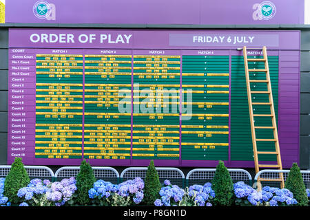 The order of play on the day information board with listings for players and matches at the Wimbledon Championships, UK - Stock Image