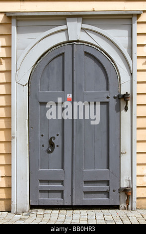 Doorway in one of the old hanseatic houses on the quay / wharf  at the Bryggen, Bergen, Norway - Stock Image