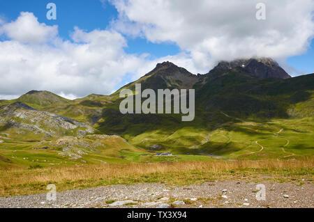 High mountain pastures and cottages in Cirque d'Anéou with Col de Peyreget and Midi d'Ossau peak (Col du Pourtalet, Portalet, Laruns, Pyrenees,France) - Stock Image