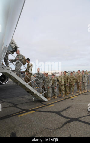 California Army National Guard Soldiers from the 649th Engineer Co. arrive at the Mather Flight Facility, Nov. 6, - Stock Image