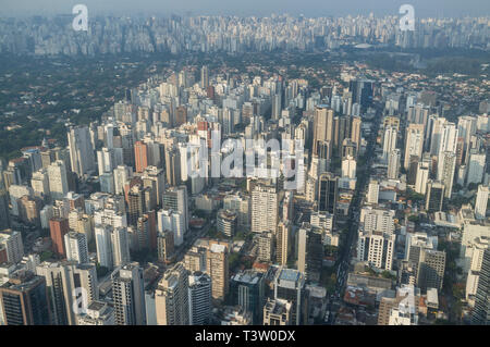 Aerial view of the city of Sao Paulo, Brazil - dense populated neighborhood - Itaim Bibi district in foreground -  mixed with green upper-class area in background (Jardins district ) and Ibirapuera Park at right. - Stock Image