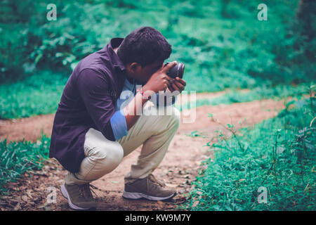Male taking Macro Photograph using lens - Stock Image