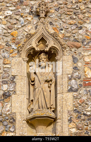 Stone statue of Saint Andrew church of Ilketshall St Andrew, Suffolk, England, UK - Stock Image