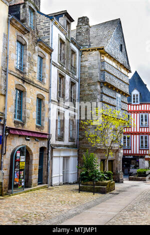 Half-timbered and stone buildings in the old medieval city of Quimper, Brittany, France. - Stock Image