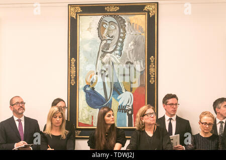 London UK. 19th June 2019. Sotheby's staff taking bids on the phone on behalf of clients  for 'Homme a la pipe' by Pablo Picasso',oil on canvas, Estimate £5,500,000, which sold at hammer for £6,500,000 at the Impressionist & Modern Art Evening Auction  at Sotheby's London Credit: amer ghazzal/Alamy Live News - Stock Image