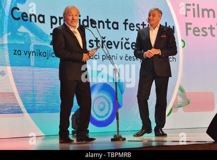 Zlin, Czech Republic. 31st May, 2019. Czech singer Karel Gott, left, takes the 'Golden Slipper' award for exceptional interpretation of songs in Czech films, within the 59th Zlin Film Festival - International film festival for children and youth, in Zlin, Czech republic, on May 31, 2019. On the right side is seen moderator Jan Censky. Credit: Dalibor Gluck/CTK Photo/Alamy Live News - Stock Image