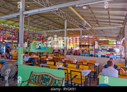 Restaurant terraces, along Moo 4, the main road, between pier and Sai Kaew Beach, Ko Samet, Thailand - Stock Image