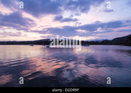 Lake Windermere and moored yachts at sunset - Stock Image