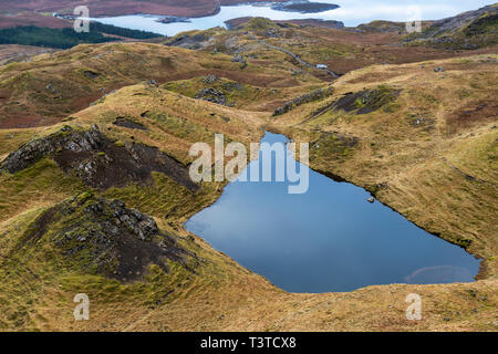 Lochan on the Trotternish ridge, with view across Loch Leathan, Isle of Skye, Highland Region, Scotland, UK - Stock Image