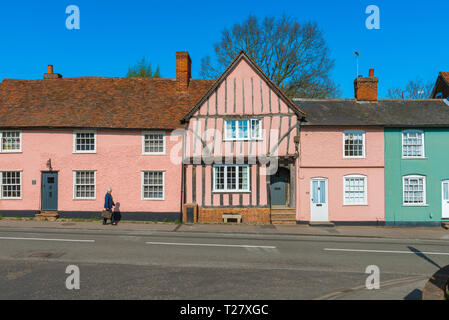 Suffolk pink, view in summer of historic buildings in Lavenham High Street  painted a characteristic pink colour typical of old Suffolk buildings, UK. - Stock Image