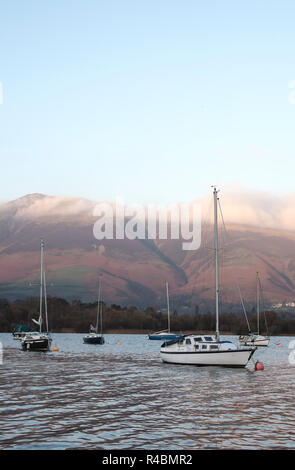 An early morning view boats and sailing boats on Derwentwater lake in Cumbria England UK - Stock Image