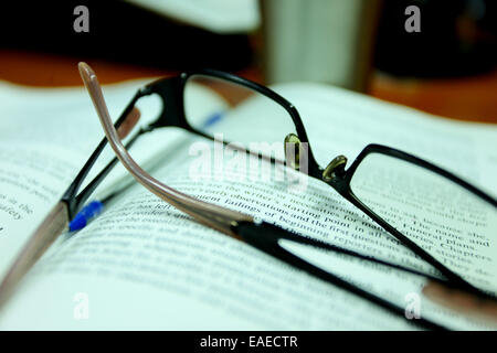 Reading glasses on a book - Stock Image