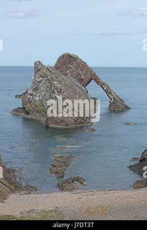 Portknockie known for its natural offshore rock arch. - Stock Image