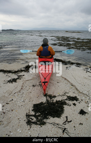 A person sea kayaking in Applecross Wester Ross Scotland Picture by Ashley Coombes/Epicscotland - Stock Image