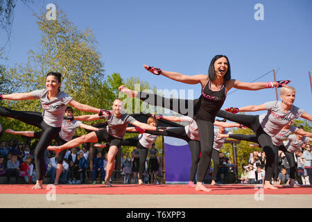 Nis, Serbia - April 20, 2019 Group outdoor Piloxing gathering in park training with instructor on sunny spring day - Stock Image