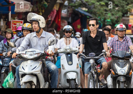 Hanoi, Vietnam - CIRCA October 2015:  it is estimated there are around 5 million scooters and motor bikes in Hanoi. Pollution becomes real problem. - Stock Image