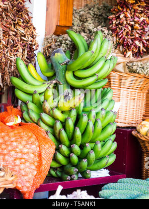 Bananas from Madeira sold on a local market in Funchal, Madeira, Portugal. - Stock Image