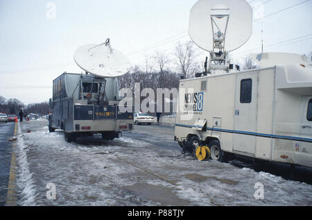 TV satelite trucks parked near a train crash - Stock Image