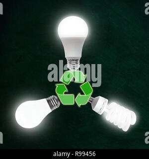 Illuminated light bulbs of LED, CFL fluorescent and incandescent technologies plugged into recycle symbol. Evolution of energy efficient bulb technolo - Stock Image
