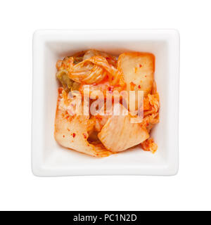 Kimchi in a square bowl isolated on white background - Stock Image
