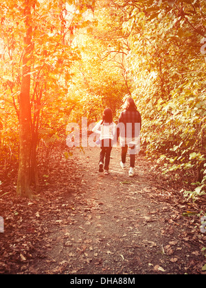 Mother and daughter walk in the woods - Stock Image